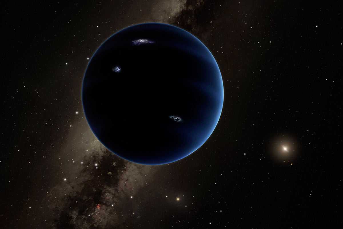 Dark blue planet with distant star in background