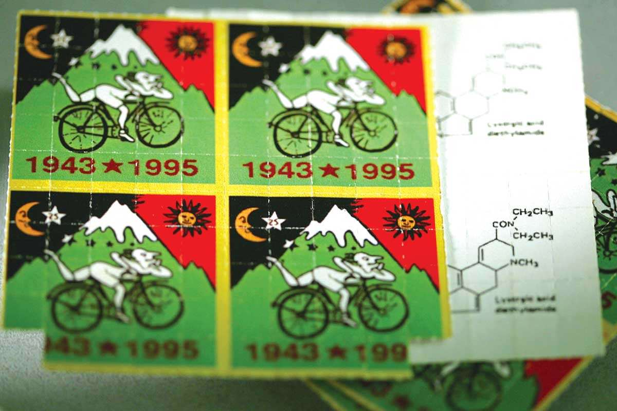 LSD tablets packaged in a sheet with colour illustration printed over it