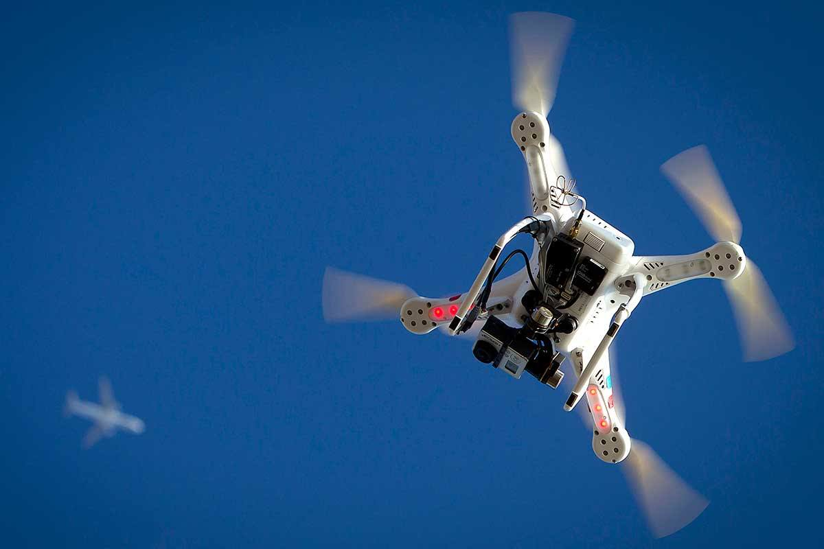 A quadcopter style drone in the sky