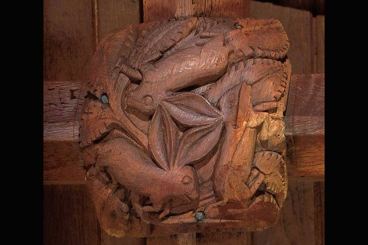 Three hares image on medieval roof boss, South Tawton, Devon, UK