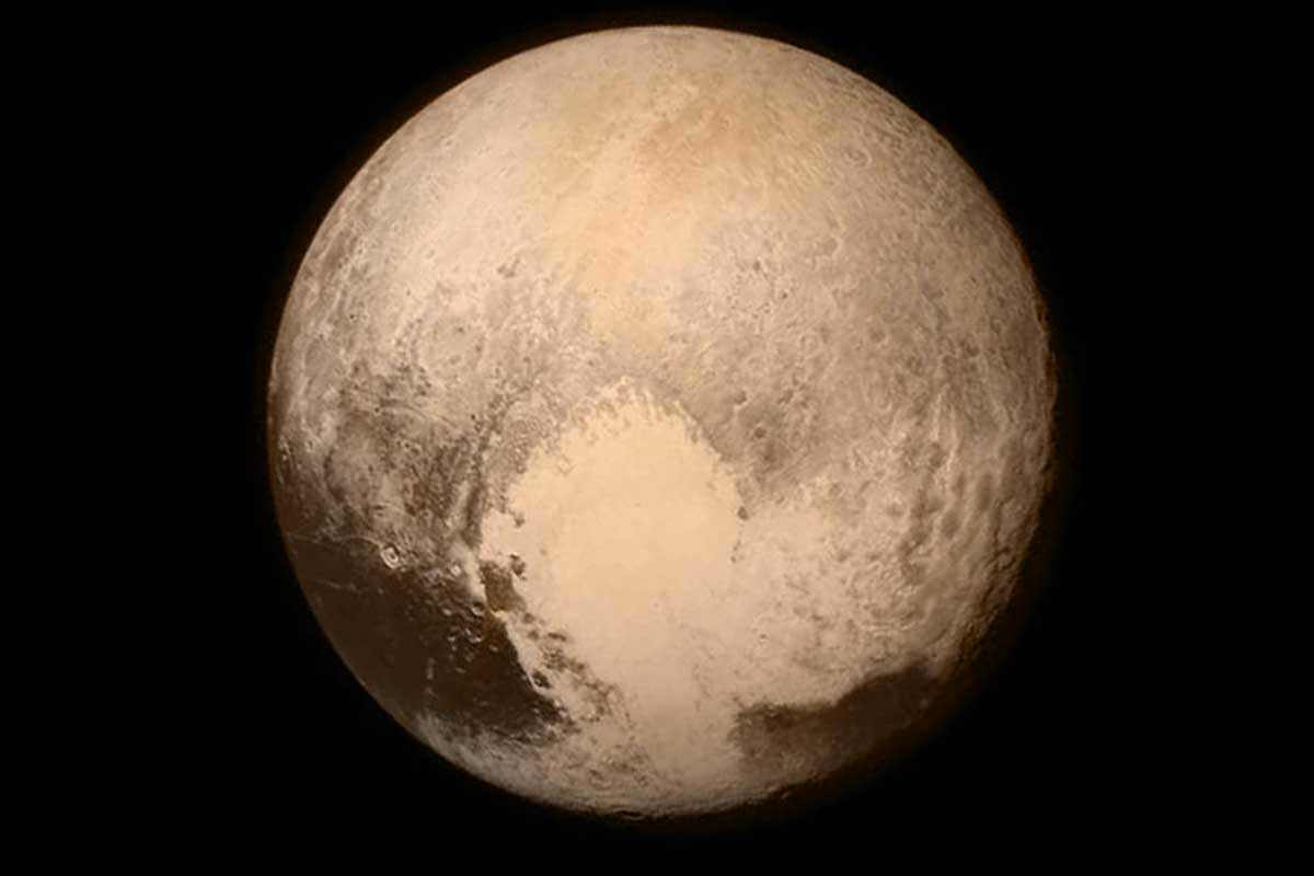 "Pluto showing heart-shaped ""Tombaugh Regio"" feature"