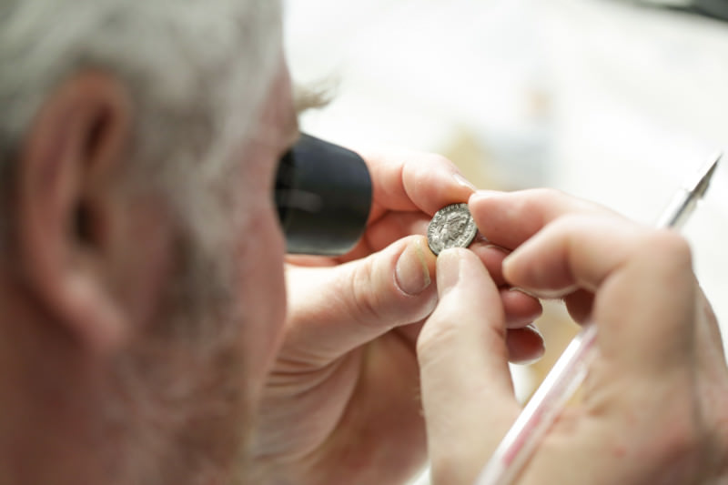 Man looking at coin