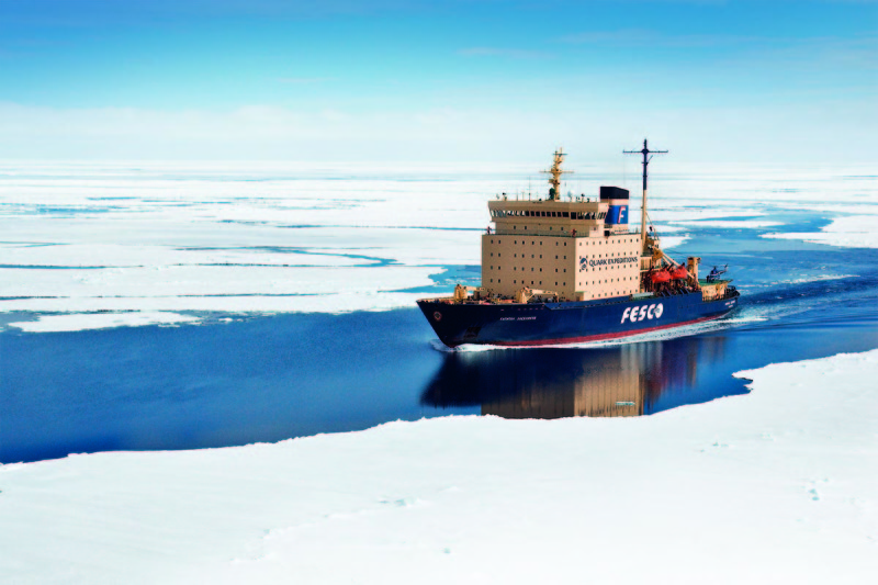 Icebreaker ship Kapitan Khlebnikov sailing through a channel in the ice