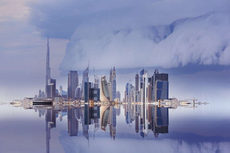 Dubai skyline reflected, stormy sky, seen from old town