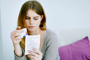 A woman reading a medical advice leaflet