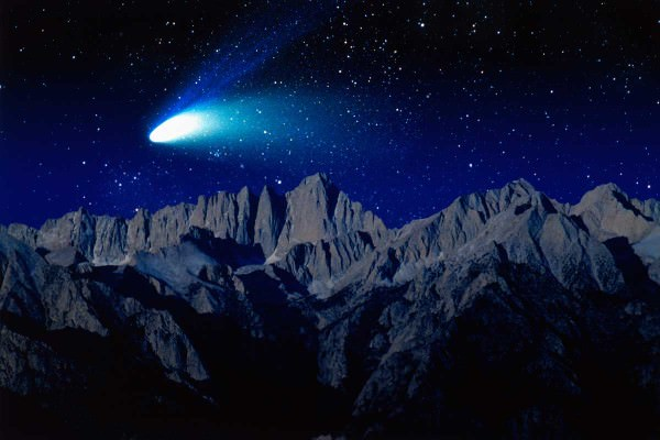 Comet over mountainous landscape