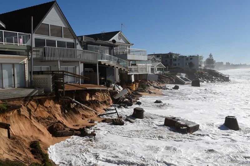 High tide begins to impact on beachfront homes already damaged by a weekend storm along the Pacific Ocean at Collaroy on the northern beaches of Sydney, June 7, 2016