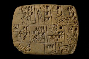 Clay tablet with cuneiform writing on it
