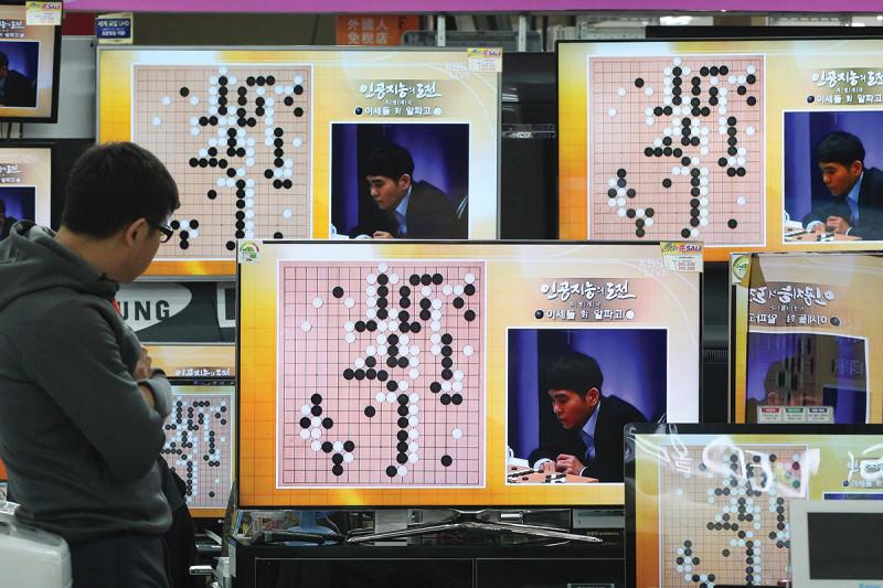 TV screens showing Go match
