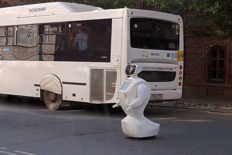 Promobot robot stands in the middle of a road
