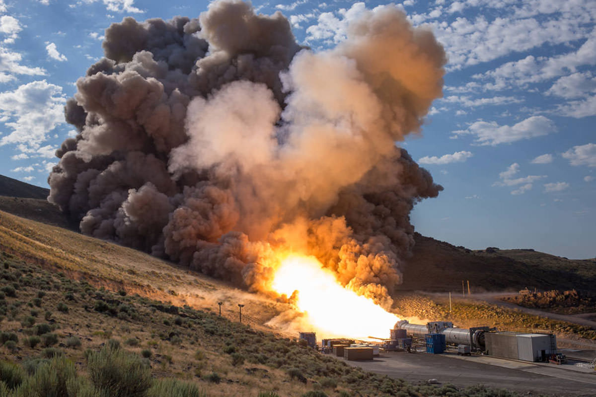 Rocket booster fires at bottom of valley
