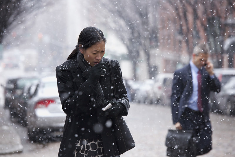 Woman coughs in snow
