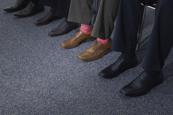 Row of feet with one person wearing bright socks
