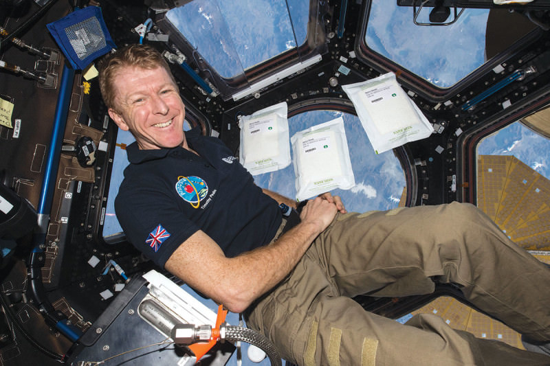tim peake smiling, and reclining in microgravity presumably on the ISS