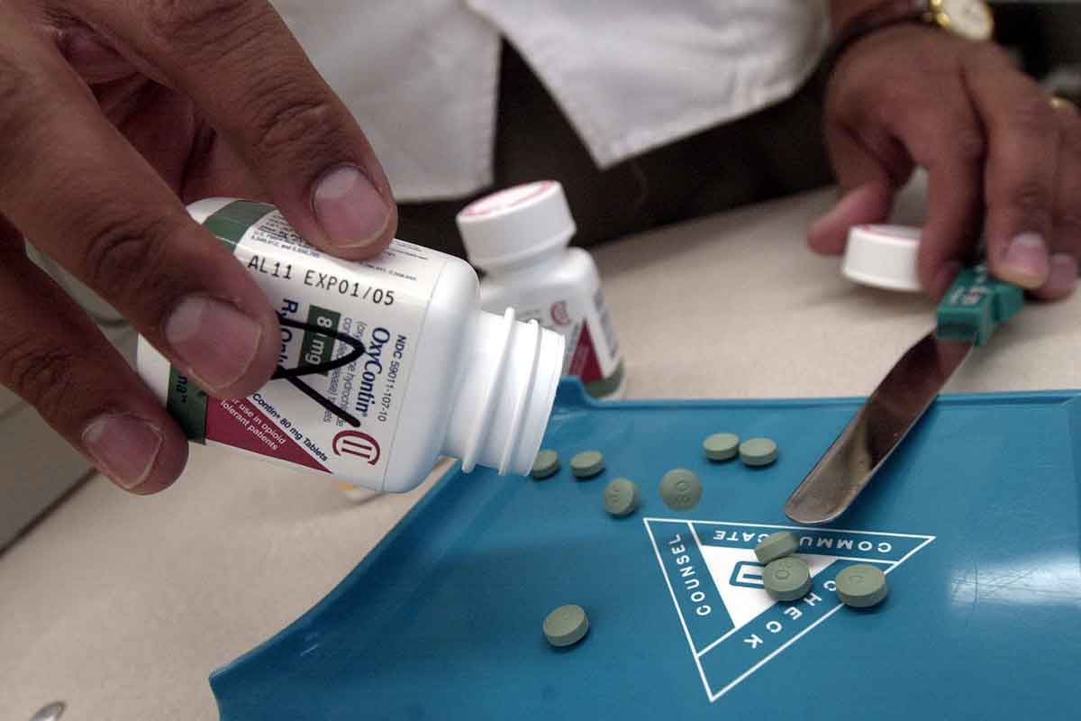Person empties out bottle of the painkiller OxyContin