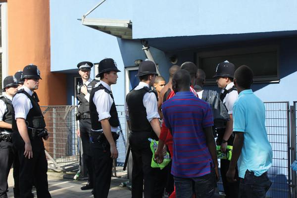 British policemen questioning black youths