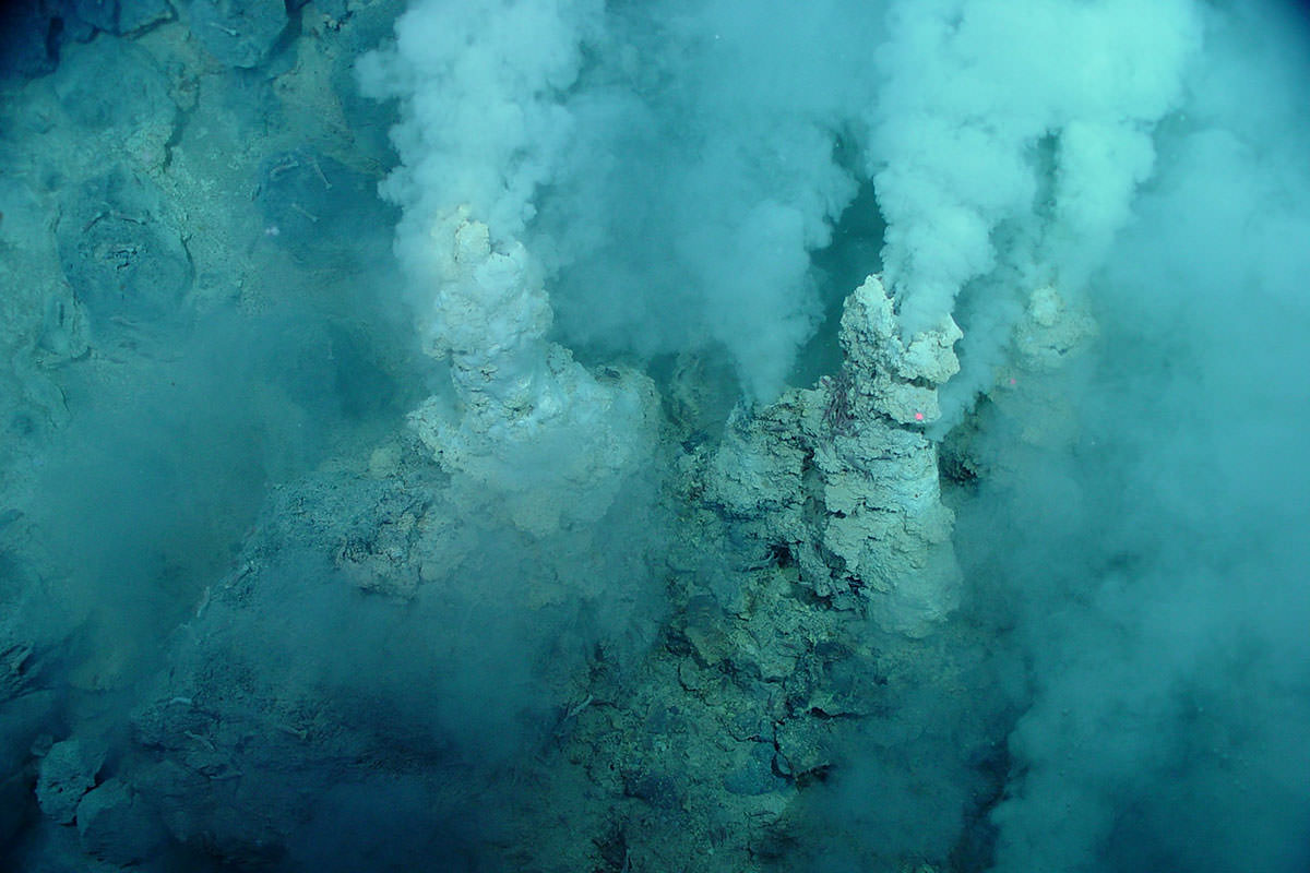 Rock chimneys spew what looks like smoke although this is actually on the seabed