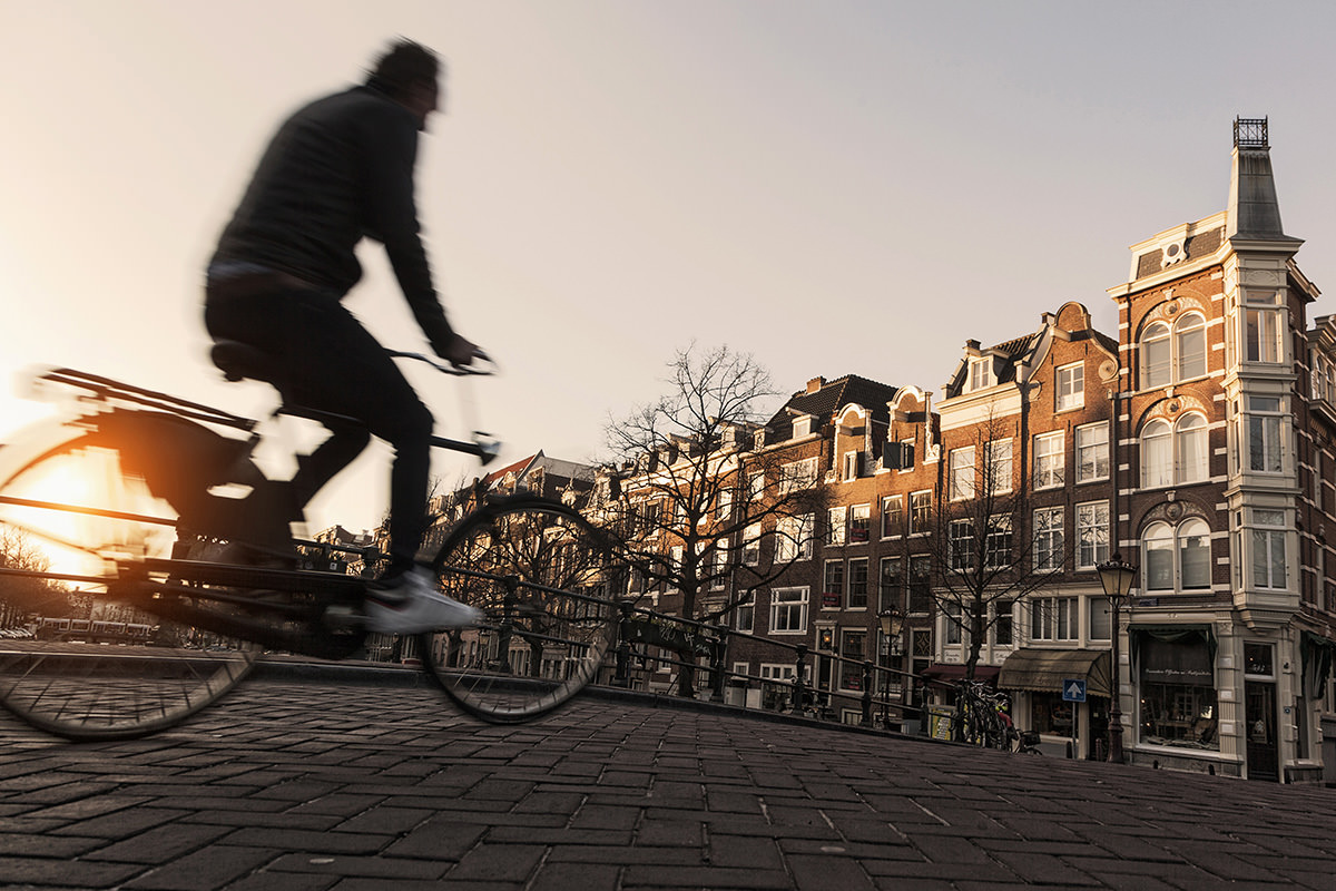 Cyclist in Amsterdam's Old Town in the Netherlands