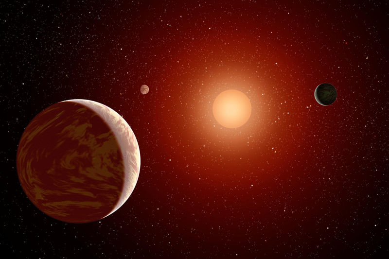 artist's impression of planets around a red dwarf star
