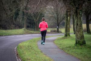 A woman jogging along a road