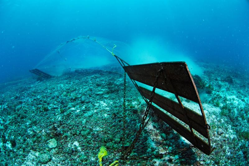 Bottom trawler scrapes the sea bed