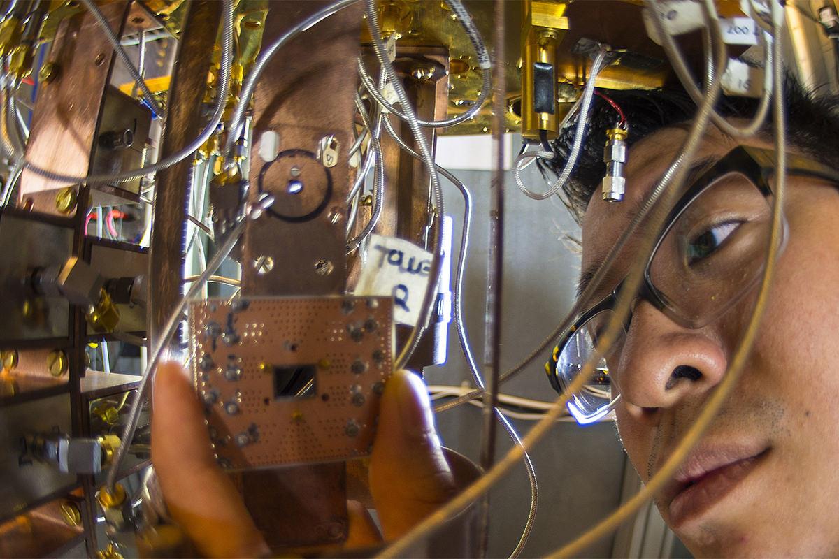 Man peers at dangling circuitry