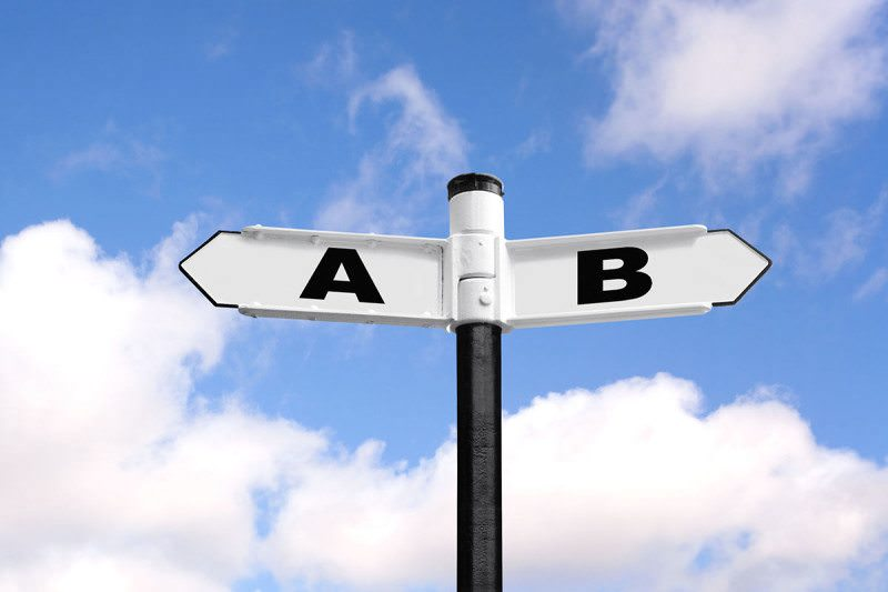 A and B sign post against a blue sky