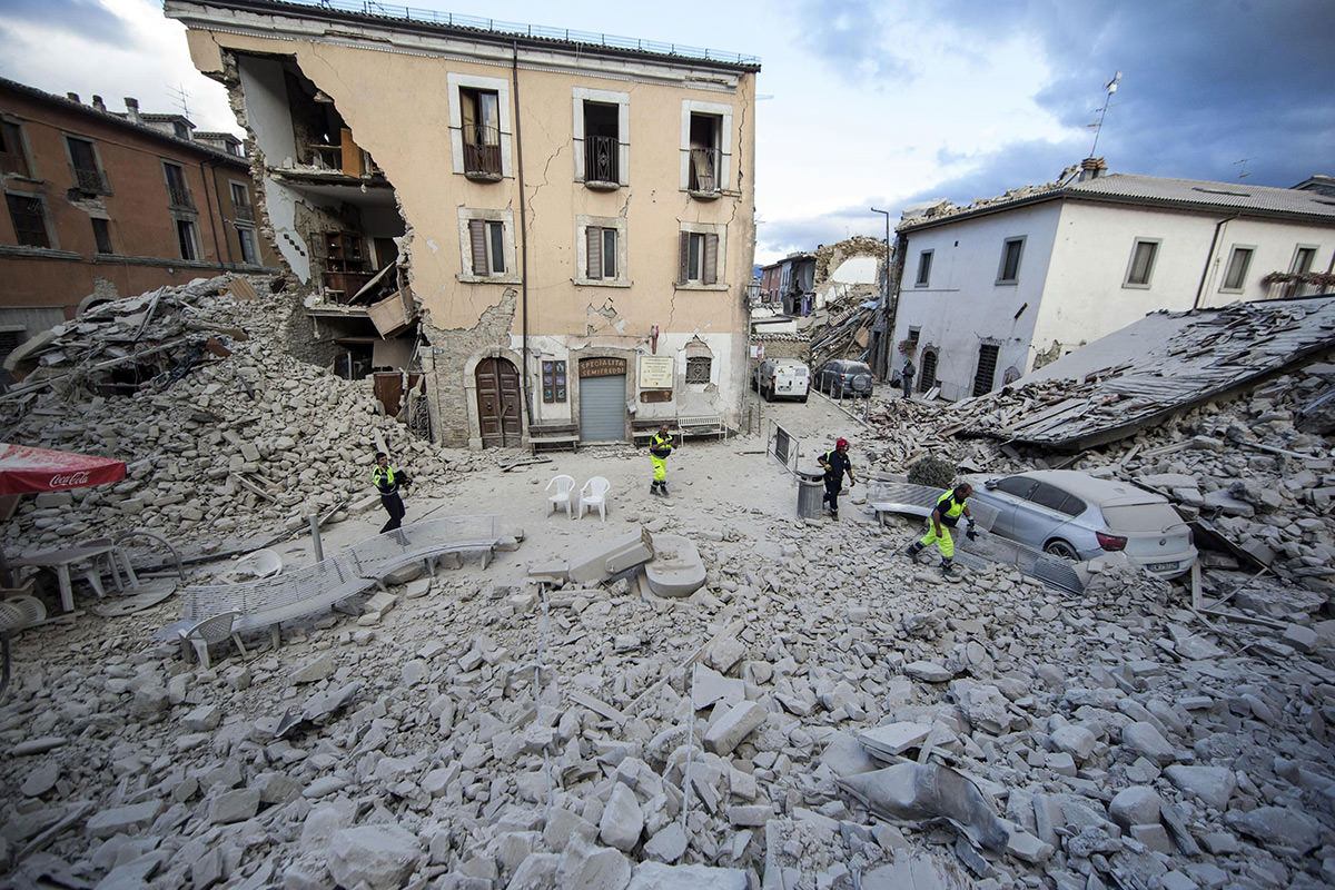 The side of a building collapsed in Amatrice following the magnitude 6 quake