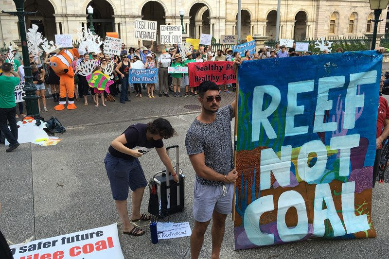 "Demonstration with banner reading ""REEF NOT COAL"""