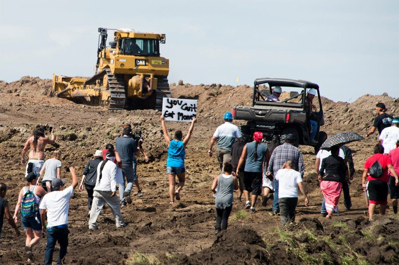 Protesters slam N. Dakota pipeline but company 'committed'