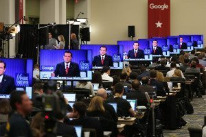 Ted Cruz appears on multiple TV screens with Google banner in background