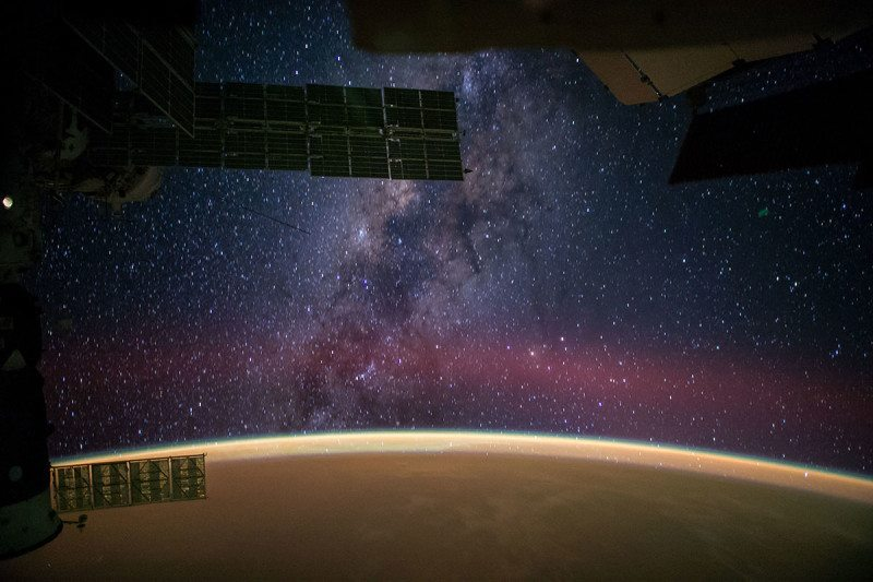 "NASA astronaut Reid Wiseman captured this image from the International Space Station and posted it to social media on Sept. 28, 2014, writing, ""The Milky Way steals the show from Sahara sands that make the Earth glow orange."""