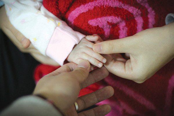 baby ad parent hands