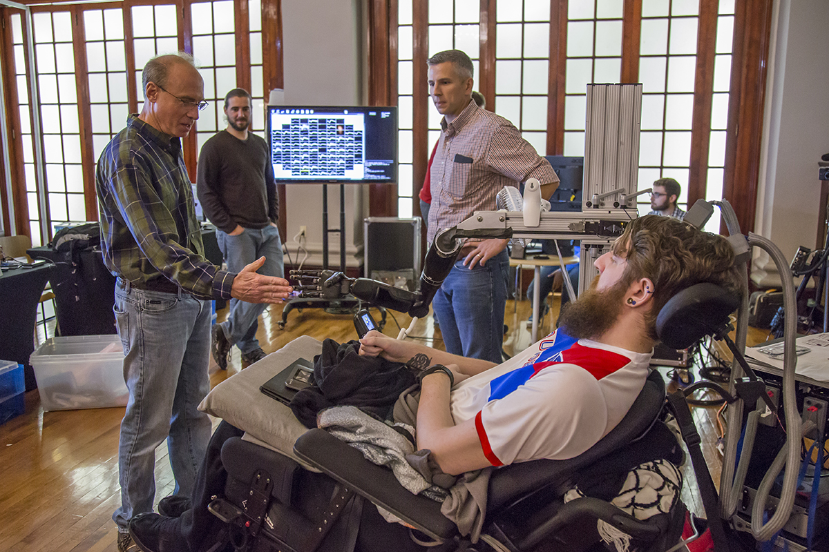 Paralyzed man feels touch through mind-controlled robot hand