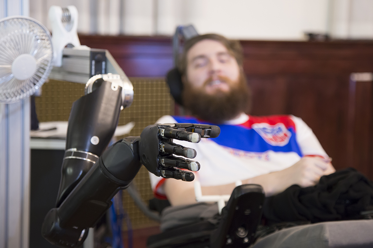 Paralysed man feels with robotic hand