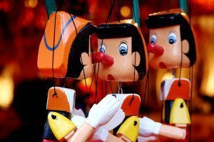A puppet of character Pinocchio, whose nose grew every time he told a lie