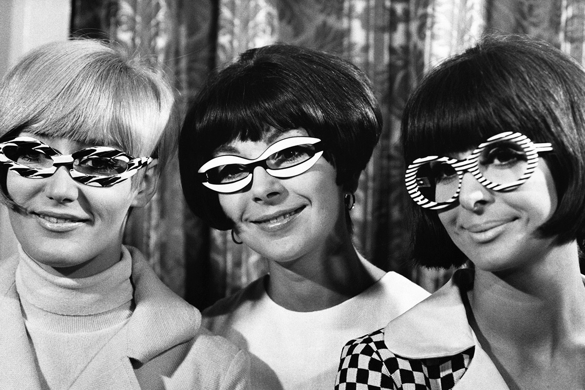 Three women wearing very large glasses