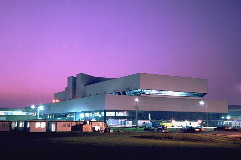 The JET building at night against a purple sky