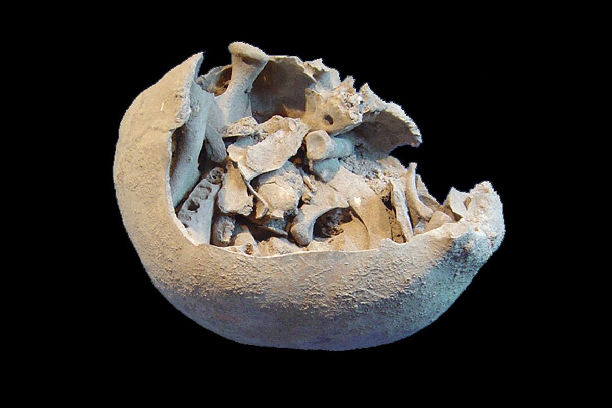 Skull casket holding human bones reveals weird burial rituals