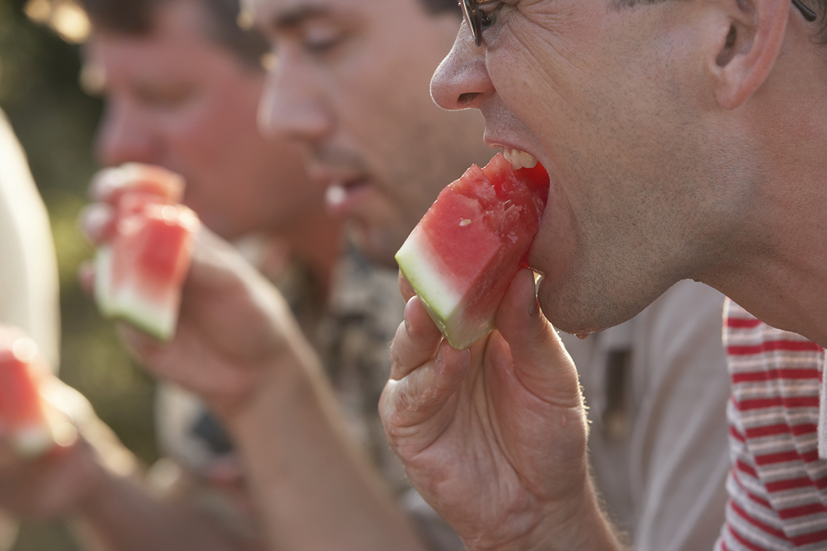 People eating watermelons together