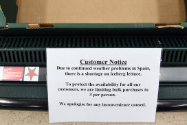 Notice warning of limits on lettuce buying, stuck on an empty box