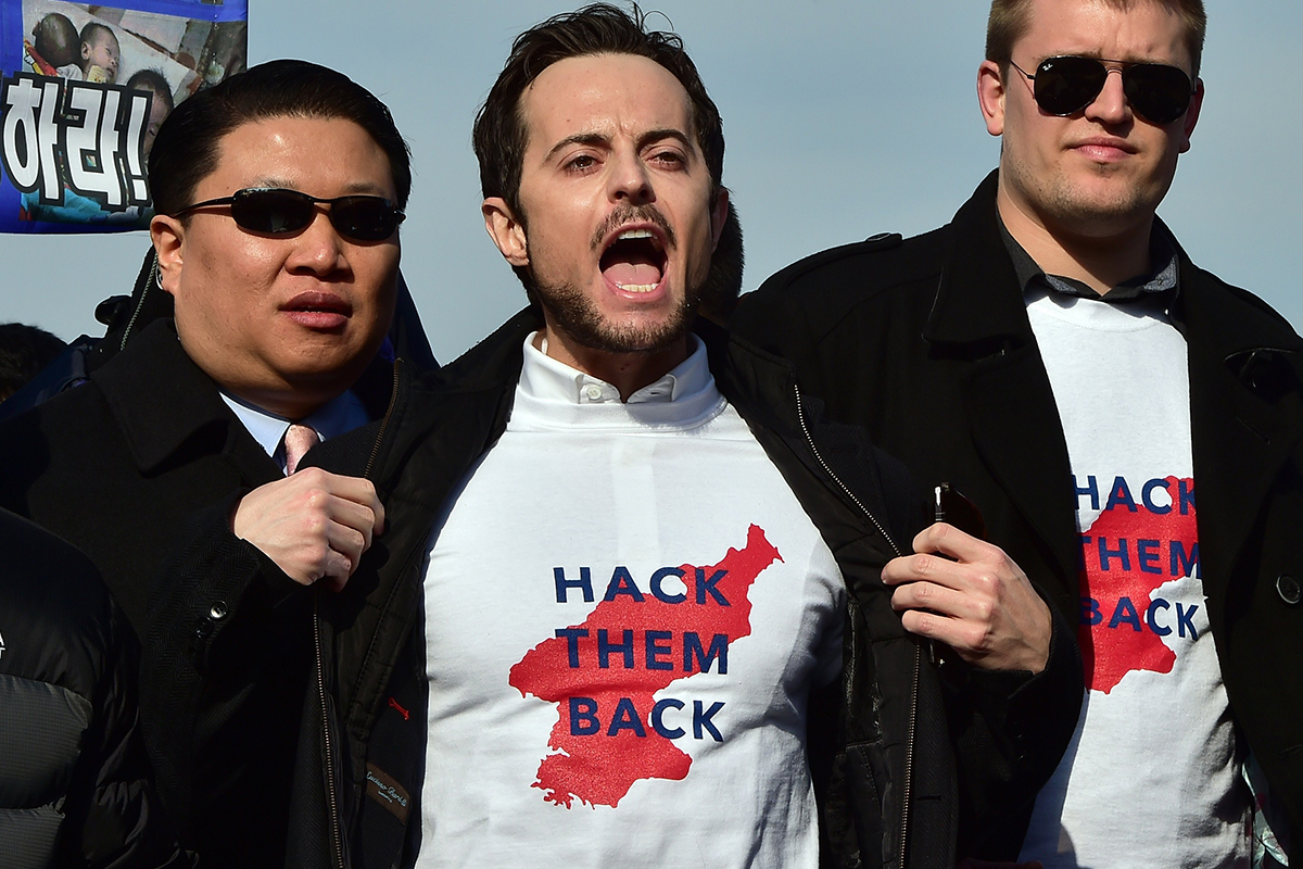 "A man wearing a ""hack them back"" t-shirt"