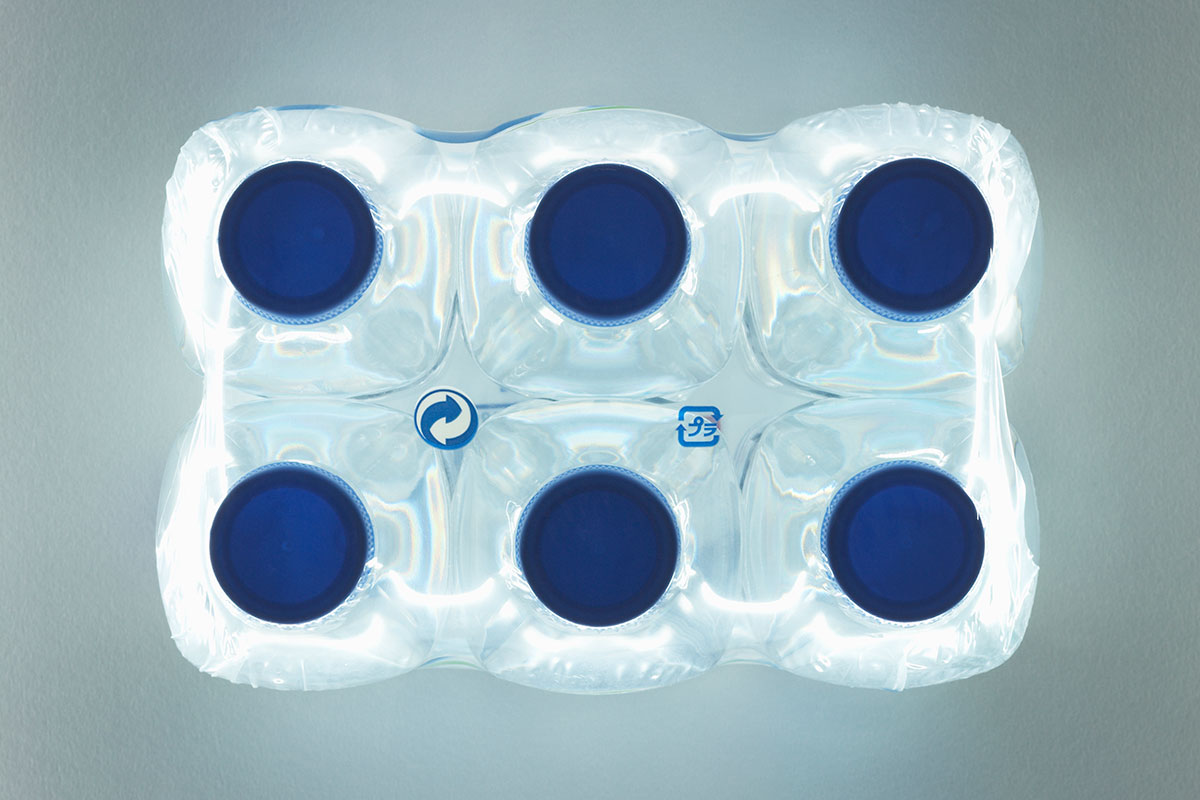 six water bottles shown from above