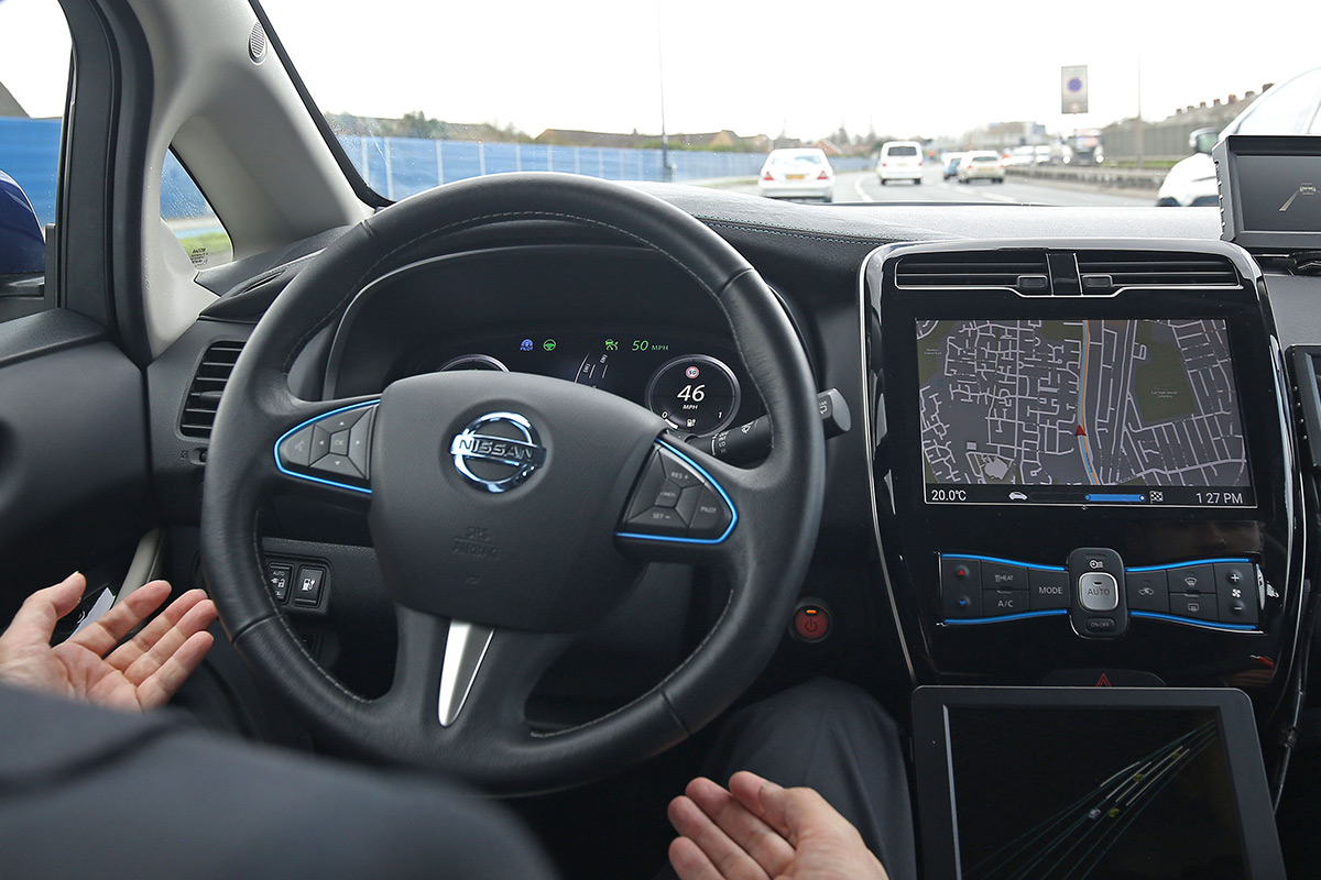 A driverless car with no hands on the steering wheel