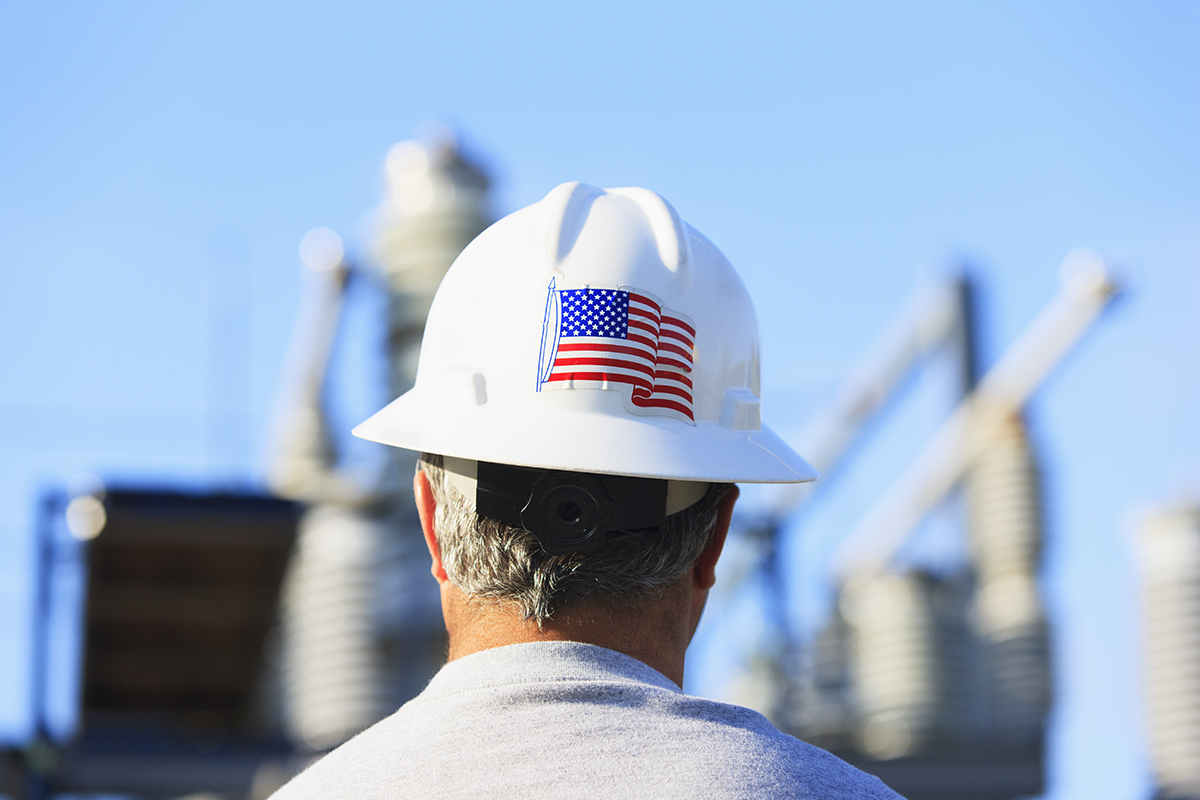 Man wears safety helmet with a sticker of US flag on the back