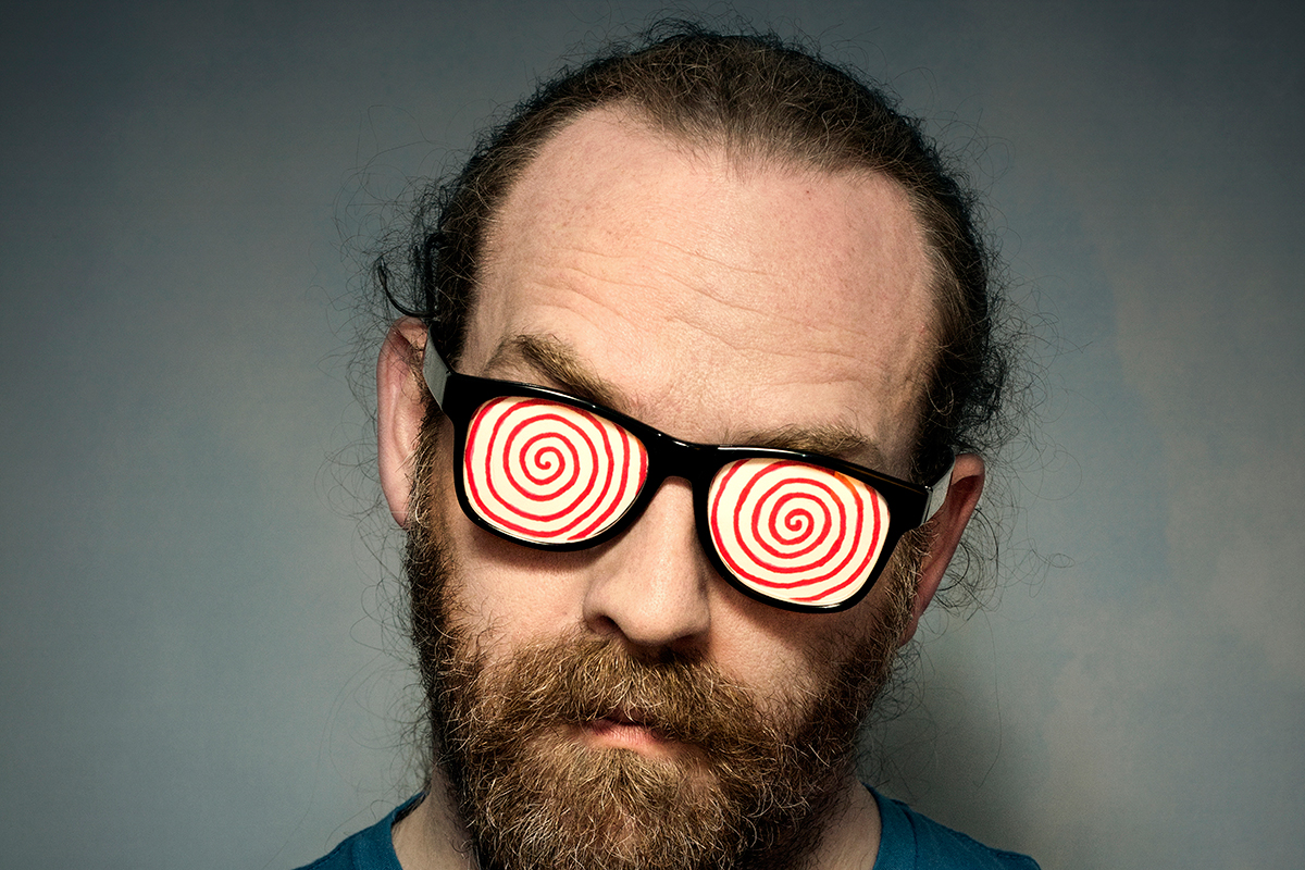 A man wearing hypnotic glasses