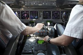 Airline pilots flying a plane