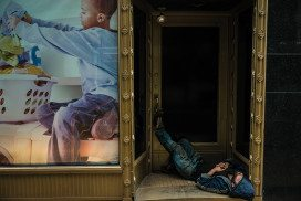 person sleeping in a doorway