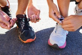 Runners tying shoelaces