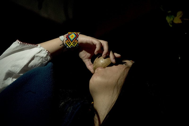Woman drinks mixture containing ayahuasca